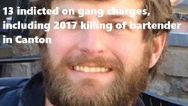 13 indicted on gang charges, including 2017 killing of bartender in Canton